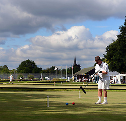 © Licensed to London News Pictures. 14/08/2013. Surbiton, UK David Maugham, England in action. People participate in the14th World Association Croquet Championship at the Surbiton Croquet Club, Kingston upon Thames on the 14th August 2013. The Final will be played on Sunday 18th August. 80 competitors from 20 countries are taking part. Photo credit : Mike King/LNP