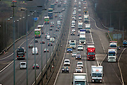 Northbound and southbound traffic on M1 Motorway near Hertfordshire, United Kingdom.