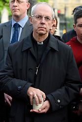 © Licensed to London News Pictures. 17/06/2016. The Archbishop of Canterbury  JUSTIN WELBY joins well wishers and tributes in Parliament Square in memory of Labour party MP JO COX. She was allegedly attacked and killed by suspect 52 year old Tommy Mair close to Birstall Library near Leeds. London, UK. Photo credit: Ray Tang/LNP