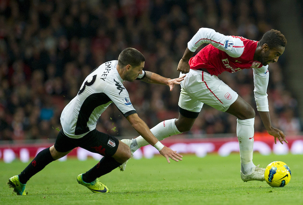 Arsenal's Alexandre Song fights for the ball with Fulham's Clint Dempsey during  their English Premier League during  their English Premier League soccer match at the  Emirates stadium in London, Saturday, Nov. 26, 2011. (AP Photo/Bogdan Maran)