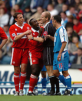Photo: Back Page Images. 16/10/2004.<br /> Barclays Premiership. Blackburn Rovers v Middlesbrough. Ewood Park.<br /> Jimmy Floyd Hasselbaink and Youri Djorkaeff have to seperated by Mike Riley after Tuguy's sending off