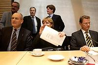 14 DEC 2003, BERLIN/GERMANY:<br /> Volker Kauder, CDU, 1. Parl. Geschaeftsfuehrer der CDU/CSU BT-Fraktion, Angela Merkel, CDU Bundesvorsitzende, und Guido Westerwelle, FDP Bundesvorsitzender, vor Beginn der Sitzung des Vermittlungsausschusses, Bundesrat<br /> IMAGE: 20031214-01-082