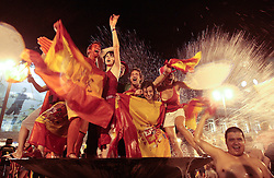 Spanish fans celebrate in a fountain in downtown Madrid after Spain defeated the Netherlands to win the World Cup soccer final, taking place in South Africa, on Sunday, July 11, 2010. Spain won 1-0..