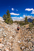 Hiker on the upper Big Pine Lakes Trail, John Muir Wilderness, Sierra Nevada Mountains, California USA