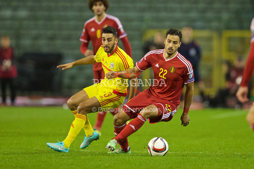 BRUSSELS, BELGIUM - Sunday, November 16, 2014: Wales' Neil Taylor and Belgium's Nacer Chadli during the UEFA Euro 2016 Qualifying Group B game at the King Baudouin [Heysel] Stadium. (Pic by David Rawcliffe/Propaganda)