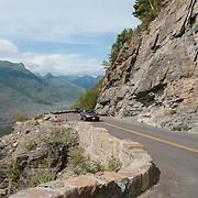 The Going to the Sun Road is a 52 mile long scenic highway that traverses Glacier National Park in Montana.