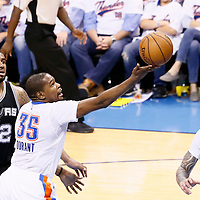 06 May 2016: Oklahoma City Thunder forward Kevin Durant (35) goes for the layup past San Antonio Spurs forward LaMarcus Aldridge (12) during the San Antonio Spurs 100-96 victory over the Oklahoma City Thunder, during Game Three of the Western Conference Semifinals of the NBA Playoffs at the Chesapeake Energy Arena, Oklahoma City, Oklahoma, USA.