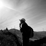 Eduardo Gutiérrez looks at the border fence near Nogales, looking for the best place to jump the fence into the United States. A new study suggests the Border Patrol can do better at figuring out what works and what doesn't to deter illegal crossings.