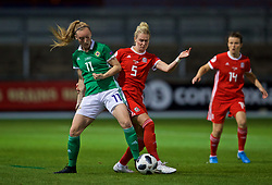 NEWPORT, WALES - Tuesday, September 3, 2019: Wales' Rhiannon Roberts (R) challenges Northern Ireland's Lauren Wade during the UEFA Women Euro 2021 Qualifying Group C match between Wales and Northern Ireland at Rodney Parade. (Pic by David Rawcliffe/Propaganda)