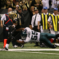 13 January 2007: New Orleans Saints running back Reggie Bush (25) crosses the goal line for a touchdown as Philadelphia Eagles linebacker Dahani Jones (55) dives for Bush's legs during a 27-24 win by the New Orleans Saints over the Philadelphia Eagles in the NFC Divisional round playoff game at the Louisiana Superdome in New Orleans, LA. The win advanced the New Orleans Saints to the NFC Championship game for the first time in the franchise's history.