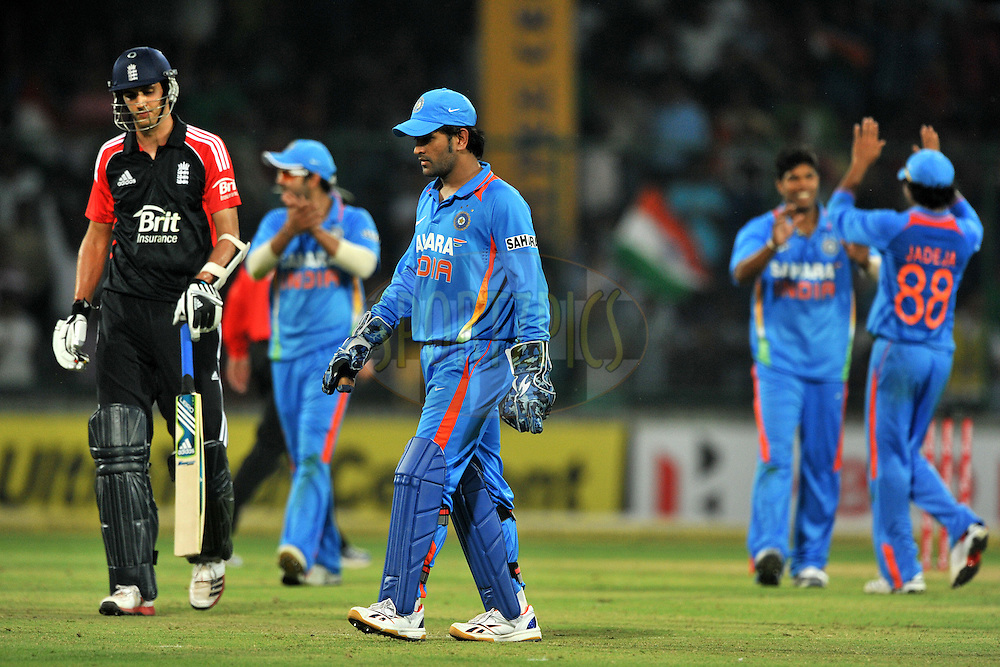 Mahendra Singh Dhoni captain of India  walks back after getting Jade Dernbach of England run-out during the 2nd One Day International ( ODI ) match between India and England held at the The Feroz Shah Kotla Stadium, Delhi on the 17th October 2011..Photo by Pal Pillai/BCCI/SPORTZPICS