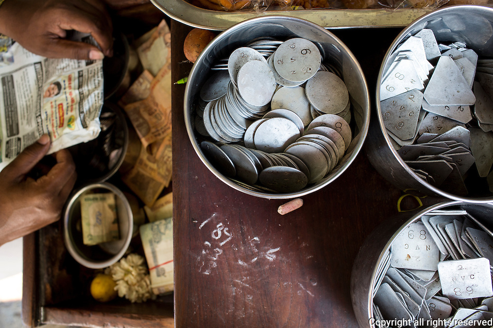 tokens used to purchase coffee and tea at Sri Gopi Iyengar Coffee and Tiffin Centre, Madurai, India