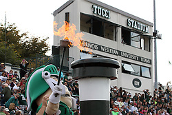 12 October 2013:  Tommy Titan lights the competition torch during an NCAA division 3 football game between the North Park vikings and the Illinois Wesleyan Titans in Tucci Stadium on Wilder Field, Bloomington IL