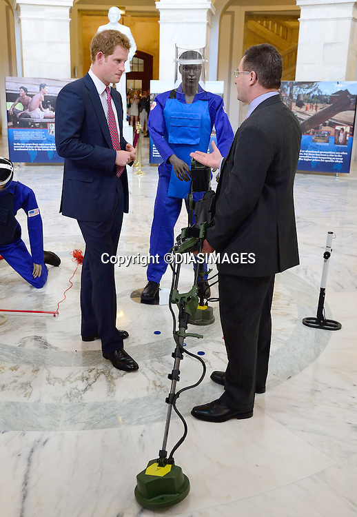"""PRINCE HARRY VISITS HALO TRUST EXHIBIT.on the occasion of their 25th anniversary, Senate Russell House, Washington DC_09/05/2013.Prince Harry has recently taken up his mother Princess Diana's mantel as Patron of the Halo Trust..The Halo Trust is involved in the stopping of the use of land mines..He was met on arrival by Republican Senator John McCain..Prince Harry is on a week long USA visit the includes Washington, Denver, Colorado Springs, New Jersey, New York and Conneticut..Mandatory credit photo:©DIASIMAGES..(Failure to credit will incur a surcharge of 100% of reproduction fees)..**ALL FEES PAYABLE TO: """"NEWSPIX  INTERNATIONAL""""**..Newspix International, 31 Chinnery Hill, Bishop's Stortford, ENGLAND CM23 3PS.Tel:+441279 324672.Fax: +441279656877.Mobile:  07775681153.e-mail: info@newspixinternational.co.uk"""