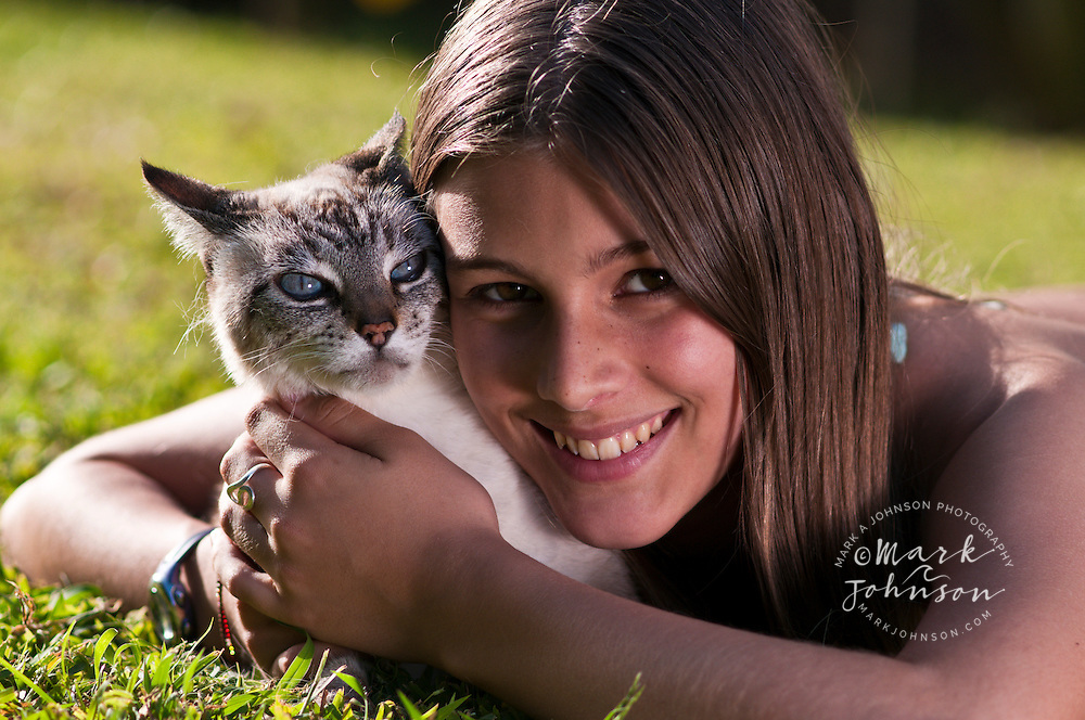 13 year old girl with her pet cat, Kauai, Hawaii