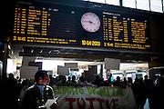 Manifestazione durante l'inaugurazione della Biennale Democrazia. Il corteo nella stazione di Porta Nuova. Torino, 10-04-'13. I migranti delle palazzine olimpiche dell'ex-moi, occupano -simbolicamente- per la terza volta l'anagrafe centrale di Torino, per rivendicare la necessità della residenza e per poter quindi accedere ai servizi di base.