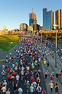 Distance runners at start of fun run from above with Melbourne CBD in background.<br /> <br /> For larger JPEGs and TIFF Contact EFFECTIVE WORKING IMAGE via our contact page at : www.photography4business.com