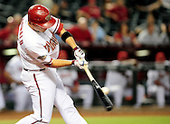 Sep. 27 2011; Phoenix, AZ, USA; Arizona Diamondbacks infielder .John McDonald (16) hits the ball during the tenth inning against the Los Angeles Dodgers at Chase Field. The Diamondbacks defeated the Dodgers 7-6 in extra innings.  Mandatory Credit: Jennifer Stewart-US PRESSWIRE