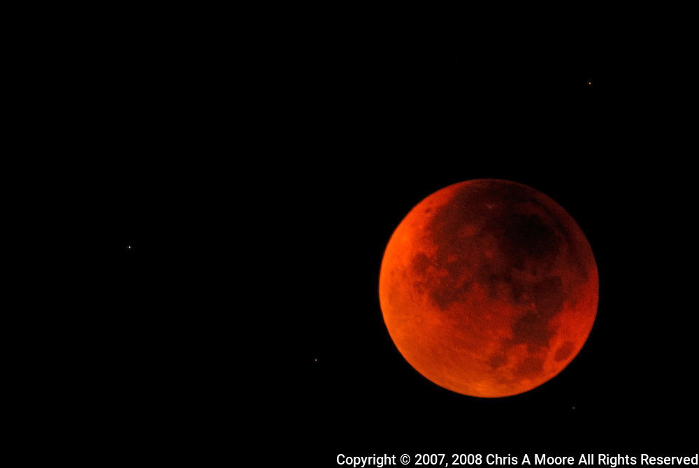 The moon is read during an eclipse of the full moon August 2007.  The image was made at Mount Goliath, Colorado at an approximate elevation of 12,150 feet to minimize the atmospheric interference.