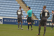 Bury Defender Reece Brown is yellow carded during the Sky Bet League 1 match between Coventry City and Bury at the Ricoh Arena, Coventry, England on 13 February 2016. Photo by Dennis Goodwin.