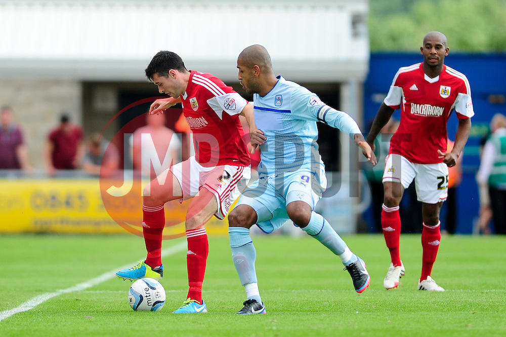 Bristol City's Brendan Moloney holds the ball up from Coventry City's Leon Clarke - Photo mandatory by-line: Dougie Allward/JMP - Tel: Mobile: 07966 386802 11/08/2013 - SPORT - FOOTBALL - Sixfields Stadium - Sixfields Stadium -  Coventry V Bristol City - Sky Bet League One