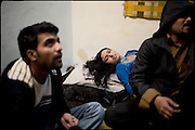 "Nadia, a young transvestite of 21 years old, in the middle of two men, tries to get his rest after a danced the whole night at a weddind party. The guys, Aman (left), 23, and a the other (rigth) are friends of a transvestites' group. Many males are interested in transvestites people,  for love, for sex or just for friendship. Men in transvestites' house enter only if they are well accept, only if they behave with dignity. Early morning in Lahore, Pakistan on Wednesday, December 03 2008.....""Not men nor women"". Just Hijira, Kusra. Painted lips, Kajal surrounding their eyes and colourful veils..Pakistan is today considered a strongly, foundamentalist as well, islamic country. But under its reputation, above all over the talebans' continuos advancing, stirs a completely extraneous world, a multiethnic mixed society. Transvestites make part of it, despite this would not be admitted by a strict law. Third gender, the Hijira are born as men (often ermaphrodites) or with an ambiguous genital situation, and they have their testicles and penis removed through a - often brutal - surgical operation. The peculiarity is that this operation does not contemplate the reconstruction of a female organ. This is the reason why they are not considered as men nor women, just Hijira. They are often discriminated, persecuted  and taxed with being men prostitutes in the muslim areas. The members of this chast perform dances during celebrations, especially during weddings, since it is anciently believed that an EUNUCO's dance and kiss in the wedding day brings good luck to the couple's fertility...To protect the identities of the recorded subjects names and specific .places are fictionals."