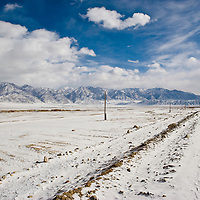 Snowy road on deserted land, Tashkurgan County, Xinjiang, China