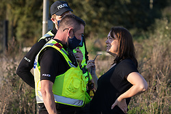 West Hyde, UK. 14th September, 2020. Hertfordshire Police officers ask a local resident to move away from a site where environmental activists from HS2 Rebellion had blocked a gate to a site for the Chiltern Tunnel on the route of the HS2 high-speed rail link. Anti-HS2 activists blocked two gates to the South Portal site for the controversial £106bn rail line, one for over six hours and the other for over twelve hours.