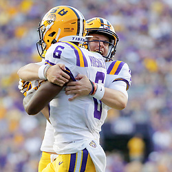 Aug 31, 2019; Baton Rouge, LA, USA; LSU Tigers quarterback Joe Burrow (9) celebrates with wide receiver Terrace Marshall Jr. (6) after a touchdown against the Georgia Southern Eagles during the second quarter at Tiger Stadium. Mandatory Credit: Derick E. Hingle-USA TODAY Sports