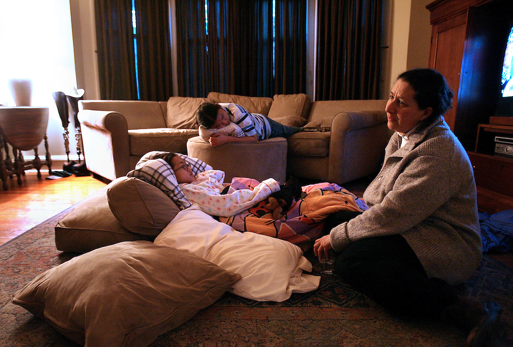 "2/14/2009 Baltimore, MD-  Lani Dickinson, 14, is comforted by her mother Julie Bell in a friend's house in the Baltimore area a day after Lani's surgery for the ""revision of her transhumeral amputation.""  Lani was born in China with a congenital defect and adopted by an American family.  Despite her disability, she trains hard as a ballerina and would like to someday be a professional dancer.  Photo by Lisa Hornak"