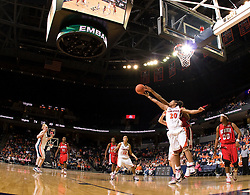 Virginia guard Kristen London (20) reaches for a rebound against NC State.  The Virginia Cavaliers defeated the NC State Wolfpack women's basketball team 74-49 at the John Paul Jones Arena in Charlottesville, VA on February 1, 2008.
