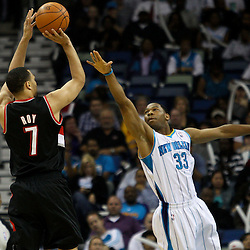 March 30, 2011; New Orleans, LA, USA; Portland Trail Blazers shooting guard Brandon Roy (7) shoots over New Orleans Hornets shooting guard Willie Green (33) during the first half at the New Orleans Arena.    Mandatory Credit: Derick E. Hingle