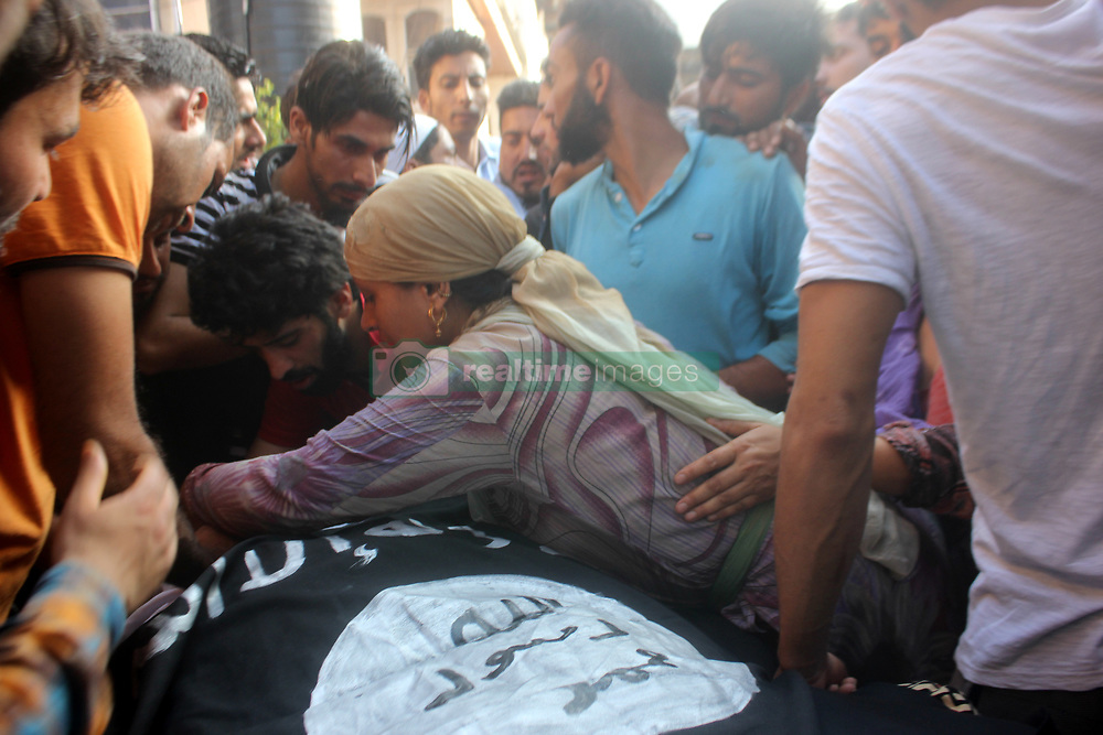 August 4, 2017 - Anantnag, Jammu and Kashmir, India - Mother hugs the dead body of a Slain Hizb rebel Yawar alias Gazi during  funeral procession in Hanfia Eidgah in Janglatandi locality of old town Anantnag, 55 KMs South  of Srinagar. Yawar a 17 day old rebel was killed in an encounter with security forces in Kanelwan village in Dochnipora belt of Bijbehara in the same district on Thursday night. Two other rebels managed to escape from the area while as a civilian- Ghulam Muhamad Bhat from Arwani village of Bijbehara was also killed in the exchange of fire. (Credit Image: © Muneeb Ul Islam/Pacific Press via ZUMA Wire)