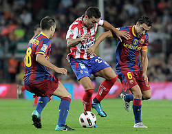 22.09.2010, Camp Nou, Madrid, ESP, Primera Division, FC Barcelona vs Sporting Gijon, im Bild Sporting de Gijon's David Barral (c) and FC Barcelona's Andres Iniesta (l) and Xavi Hernandez during La Liga match. EXPA Pictures © 2010, PhotoCredit: EXPA/ Alterphotos/ Acero +++++ ATTENTION - OUT OF SPAIN / ESP +++++
