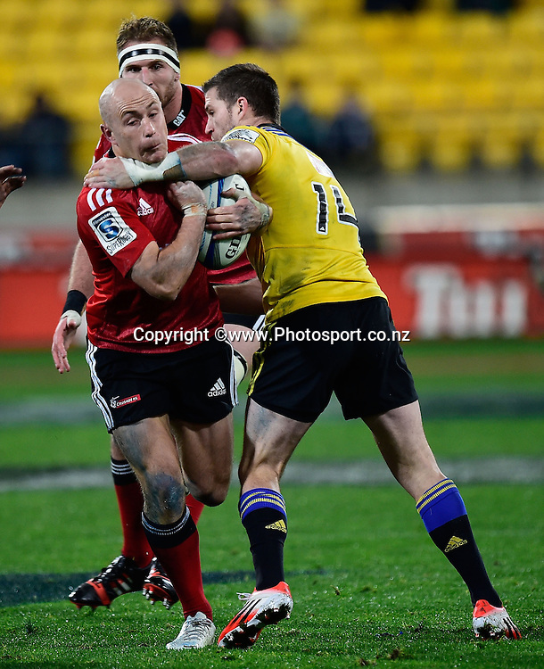 Willi Heinz (L) of the Crusaders is tackled by Cory Jane of the Hurricanes during the Super Rugby - Hurricanes v  Crusaders rugby match at the Westpac Stadium in Wellington, New Zealand on the 28th of June 2014. Photo: Marty Melville/www.Photosport.co.nz