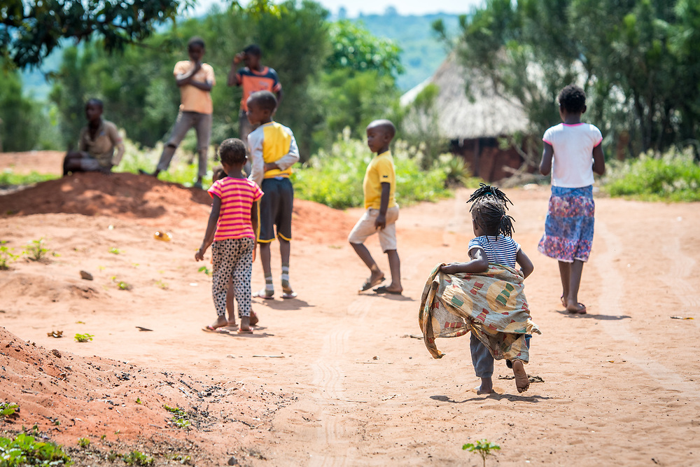 Group of Zambian children run along together, Mukuni Village, Zambia