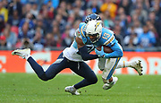LONDON, ENGLAND - OCTOBER 21: defensive back Kenneth Durden (20) Of The Titans tackles  wide receiver Keenan Allen (13) of The Chargers during the NFL game between Tennessee Titans and Los Angeles Chargers at Wembley Stadium on October 21, 2018 in London, United Kingdom. (Photo by Mitchell Gunn/Pro Lens Photo Agency) *** Local Caption *** Keenan Allen; Kenneth Durden