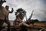 Members of newly formed community militias fire an anti aircraft gun in Benghazi on Feb. 26, 2011.