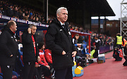 Alan Pardew watches on during the Barclays Premier League match between Crystal Palace and Watford at Selhurst Park, London, England on 13 February 2016. Photo by Michael Hulf.