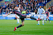 Leeds United defender Stuart Dallas (15)  during the EFL Sky Bet Championship match between Huddersfield Town and Leeds United at the John Smiths Stadium, Huddersfield, England on 7 December 2019.