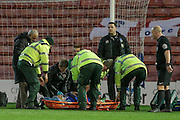 Concern as Brian Wilson (Oldham Atheltic) has a neck brace put on and is stretchered off the pitch in the first half after receiving an accidental knee to the head during the Sky Bet League 1 match between Barnsley and Oldham Athletic at Oakwell, Barnsley, England on 12 April 2016. Photo by Mark P Doherty.