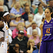 Chiney Ogwumike, (left), Connecticut Sun and Brittney Griner, Phoenix Mercury,  in action during the Connecticut Sun Vs Phoenix Mercury WNBA regular season game at Mohegan Sun Arena, Uncasville, Connecticut, USA. 23rd May 2014. Photo Tim Clayton