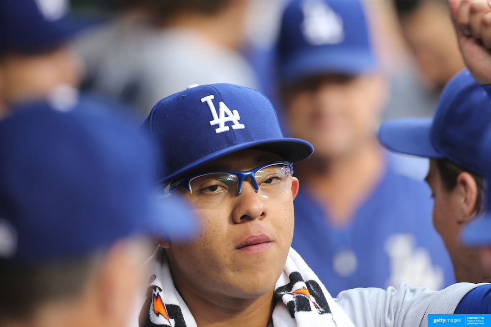 NEW YORK, NEW YORK - May 22:  Pitcher Julio Urias #78 of the Los Angeles Dodgers with team mates in the dugout before pitching during the Los Angeles Dodgers Vs New York Mets regular season MLB game at Citi Field on May 27, 2016 in New York City. (Photo by Tim Clayton/Corbis via Getty Images)