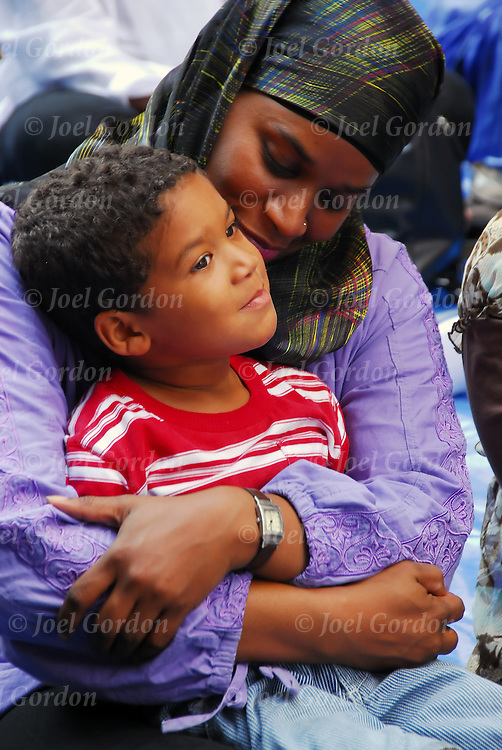 African Muslim American Mother hugging here son at the American Muslim Day Parade.