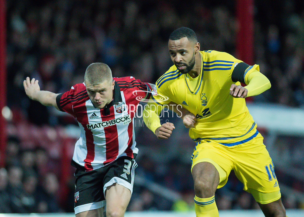 Nottingham Forest midfielder Liam Trotter and Brentford defender Jake Bidwell fight for the ball during the Sky Bet Championship match between Brentford and Nottingham Forest at Griffin Park, London, England on 21 November 2015. Photo by David Charbit.