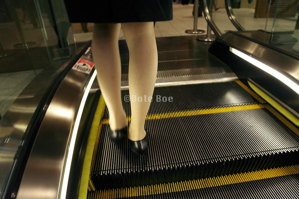 young woman coming of an escalator Tokyo Japan