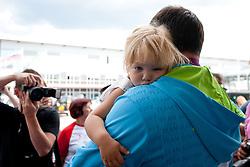 Primoz Kozmus with his daughter during reception of Slovenian Olympic team, on August 10, 2012 in Airport Joze Pucnik, Brnik, Slovenia.  (Photo by Matic Klansek Velej / Sportida)