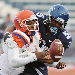 TOM KELLY IV &mdash; DAILY TIMES<br /> SHS QB Jared Johnson (15) gets sacked by Villanova's Jordan Hunter (55) causing a fumble which was recovered by SHS during the Sam Houston State University at Villanova University NCAA FCS Division 1 - AA quarterfinal game at Villanova Stadium.