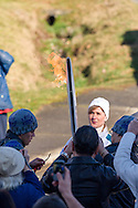 Coleen Christie's torch is lit during the 2010 Olympic Winter Games Torch Relay.  Photographed in Langley (Aldergrove), British Columbia, Canada.