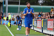 AFC Wimbledon midfielder Anthony Wordsworth (40) applauding after being subbed during the EFL Sky Bet League 1 match between AFC Wimbledon and Rochdale at the Cherry Red Records Stadium, Kingston, England on 5 October 2019.